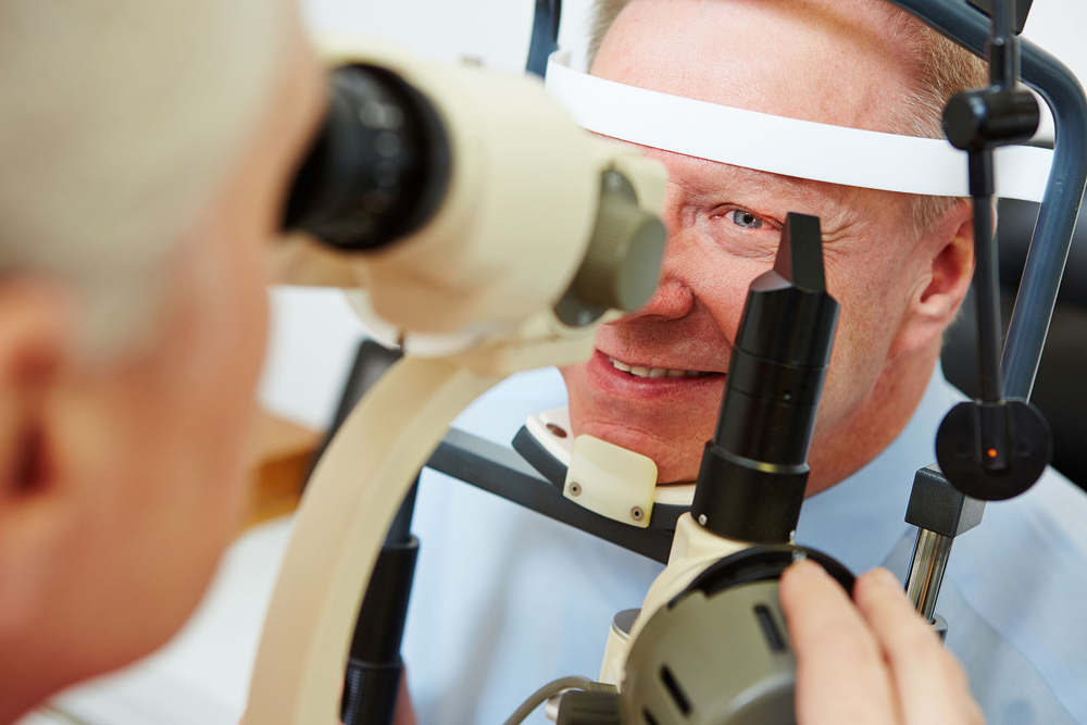 man receiving glaucoma treatment by optometrist