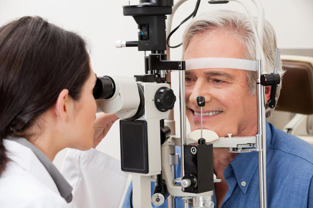 patient getting eye exam by optometrist